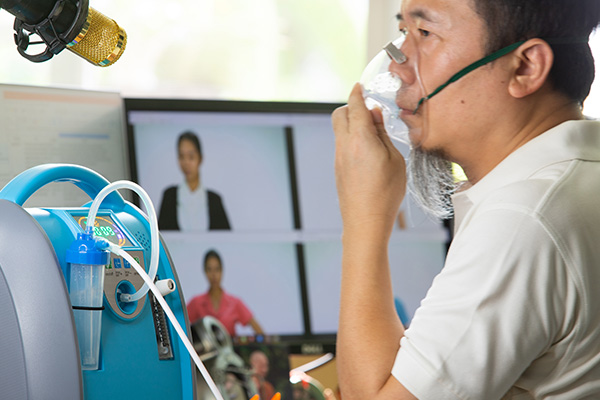 elderly man with an oxygen machine